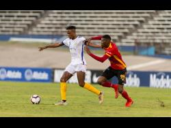 Waterhouse's Stephen Williams (left) is challenged by Keyner Brown of CS Herediano in their Scotiabank Concacaf League match played at the National Stadium on Thursday, August 22, 2019.