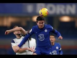 Chelsea's Ben Chilwell  heads the ball next to Tottenham's Harry Kane  (left) during their English Premier League match at Stamford Bridge in London, England, yesterday.