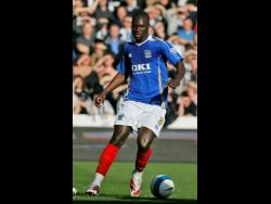 In this file photo dated Saturday, April 12, 2008, Portsmouth's Papa Bouba Diop is seen in action against Newcastle during their English Premier League match at Fratton Park Stadium in Portsmouth, England.