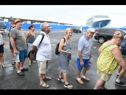 Passengers from the 'Marella Discovery' prepare to tour Port Royal when the crusie ship docked in the historic city on January 20.