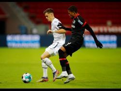 Hoffenheim's Christoph Baumgartner, left, and Bayer Leverkusen's Leon Bailey battle for the ball during the Bundesliga match between Bayer Leverkusen v TSG 1899 Hoffenheim in the BayArena, Leverkusen, Germany, yesterday.