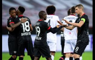 Leverkusen's Leon Bailey, Wendel, goal scorer Moussa Diaby and Lars Bender, from left, cheer after the goal for the 3:1 during the Europa League group C match between Bayer Leverkusen and OGC Nice in Leverkusen, Germany, last Thursday.