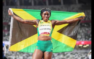 Elaine Thompson-Herah celebrates her win in the women's 200m final at the Tokyo 2020 Olympic Games in Japan.