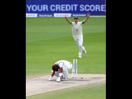 FILE West Indies' Shai Hope is bowled out by England's Stuart Broad during the last day of the second cricket Test match between England and West Indies at Old Trafford in Manchester, England, Monday, July 20, 2020.